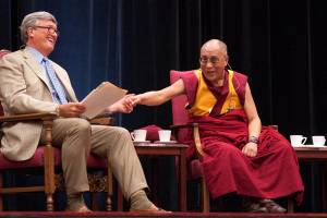 James Doty, left, director and founder of the Center for Compassion and Altruism Research and Education, and the Dalai Lama at the morning lecture at Maples Pavilion.