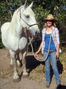 Wrangler Erin Bolster and Tonk, a Percheron mix.