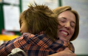 Teacher Carrie Gelson gets a hug from student Deandra at Vancouver's Seymour Elementary. Photograph by: Ward Perrin, PNG