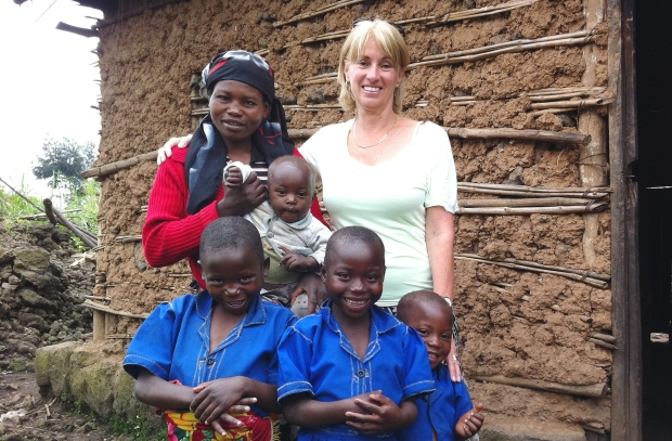Judy McLean, an assistant professor in UBC's faculty of land and food systems, with a Rwandan mother and her children. UNICEF and the government of Rwanda have invited a professor from the University of B.C. to expand a 12-month nutritional pilot study involving 1,100 children into a national program for nearly half a million toddlers aged six months to two years.